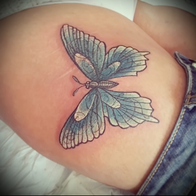 butterfly tattoo on her leg