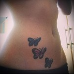 butterfly tattoo on her stomach
