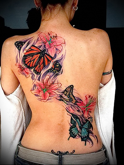 butterfly tattoo on the back of the photo