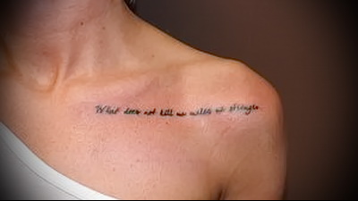 tattoo inscription on the collarbone