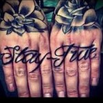 tattoo lettering on the fingers