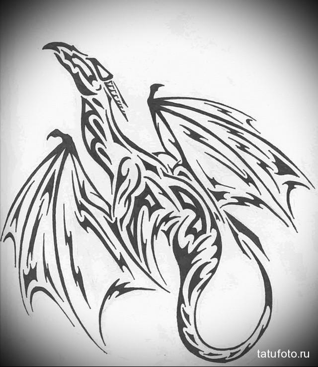 sketch dragon tattoo on shoulder blade