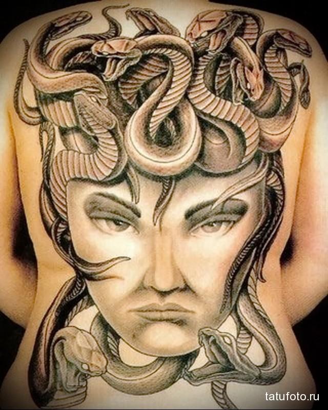 snake tattoo on her back