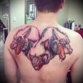 татуировка цербер на спине - пес с тремя головами