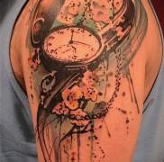 Значение татуировки часы 3
