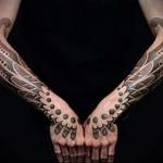 два больших пера в парной татуировке на руку