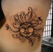 татуировка солнце выполненное точками на теле