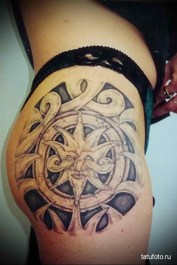 татуировка солнце на бедре + народные узоры маори