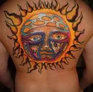 татуировка солнце на всю спину и скелеты