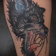 что значат татуировки с оскалом волка – фото