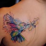птичка у цветка - тату акварель фото