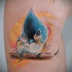 синяя птичка на ветке - тату акварель фото