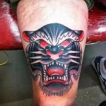 тату голова тигра - черный вариант выше колена