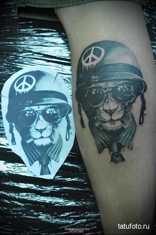 тату лев в очках и каске