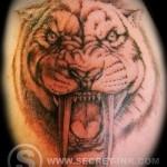 тату оскал тигра - саблезубый тигр с длинными клыками