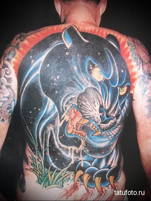 тату пантера - большой рисунок с оскалом на всю спину