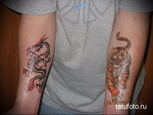 тигр и дракон тату на предплечье мужчины