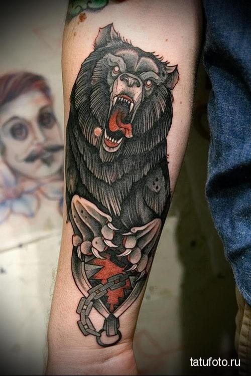 Bear tattoo on the forearm 1