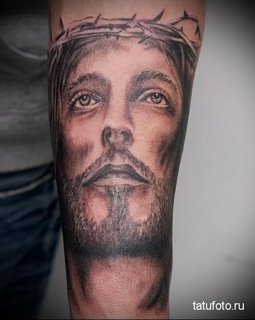 Jesus tattoo on the forearm 1