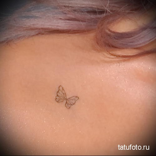 butterfly tattoo on her collarbone 2