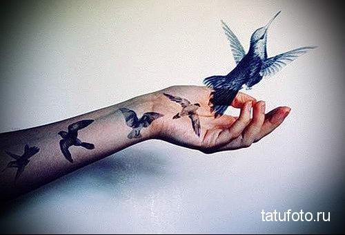hummingbird tattoo on his arm 2