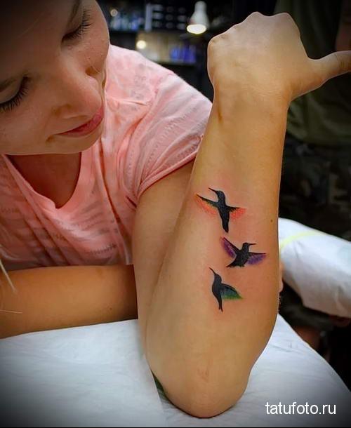 hummingbird tattoo on his arm 3