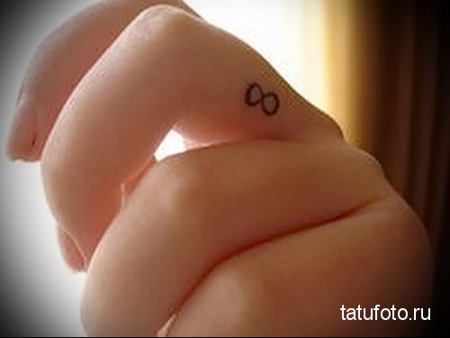 infinity tattoo on her finger 2