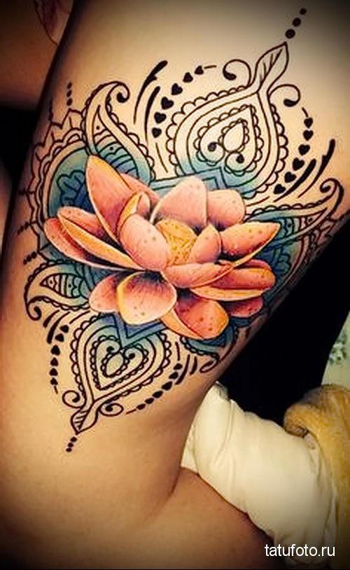 lotus tattoo on her leg 1