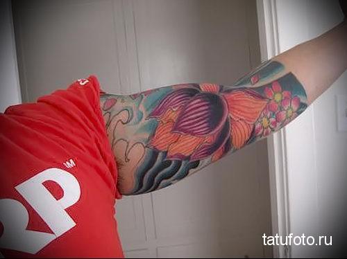 lotus tattoo on his arm 1