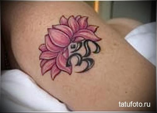 lotus tattoo on his arm 2