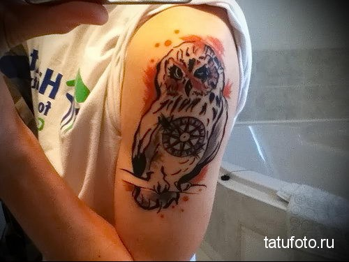 owl tattoo on his shoulder 1