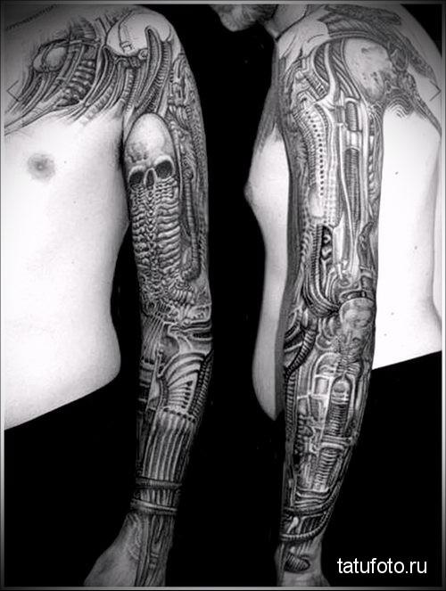 tattoo on his forearm biomechanics Black and white men 1