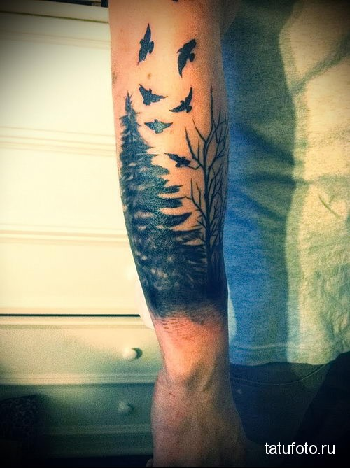 tattoo on his forearm forest 1