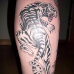 tiger tattoo on his leg 1