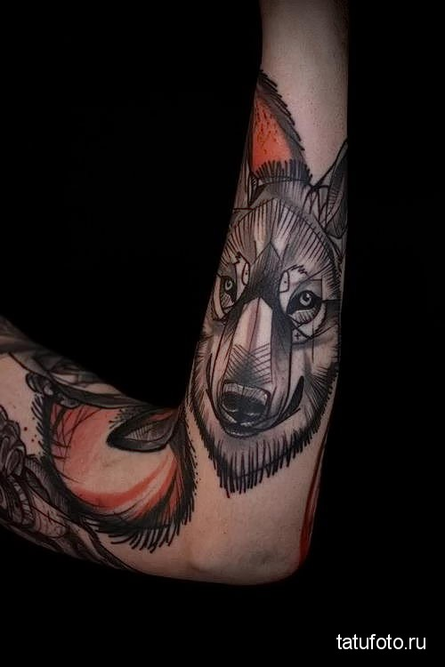 wolf tattoo on the forearm 3
