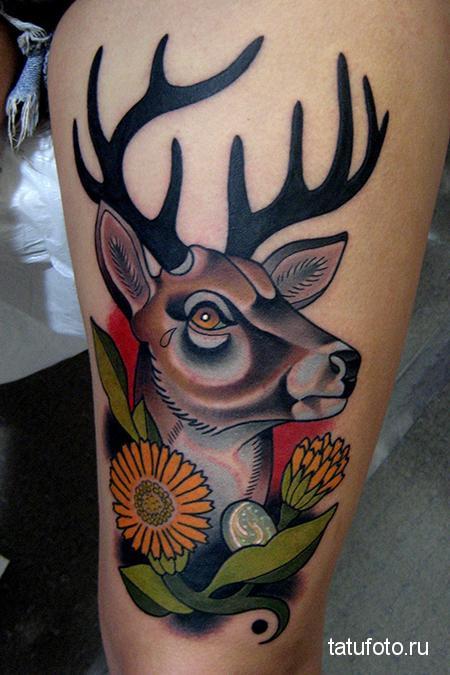 Тату олень тату олень в цветах на ногу выше колена