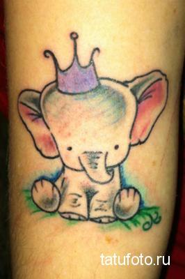 Тату слона в короне
