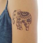 Тату слон на плече для женщины