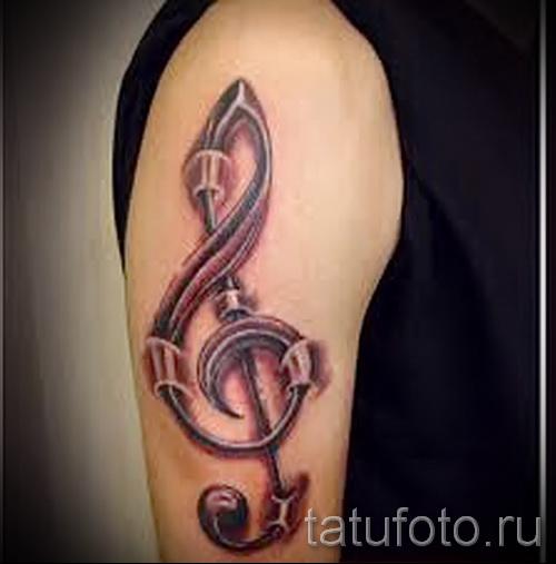 тату скрипичный ключ на руке 4 фото