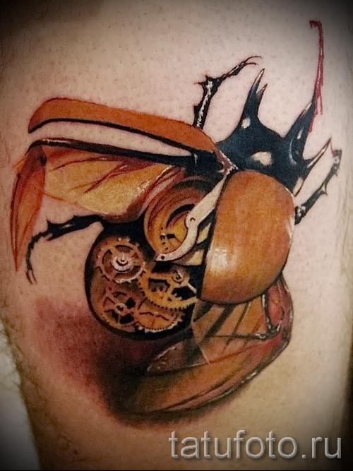 Тату насекомые - жук с шестеренками внутри