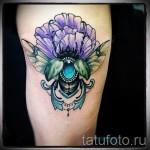 Тату насекомые - майский жук и яркий цветок
