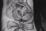 Блатная тату с котом – на удачу и символизирует осторожность