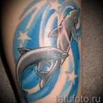 Тату дельфин и звезды