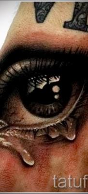 Тату слеза под глазом – пример на фото – 1