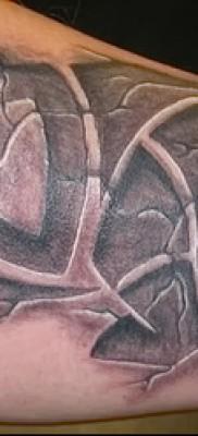 Фото пример тату носорог и надпись power