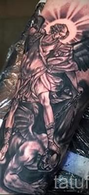 Фото тату архангел Михаил пример на предплесье для мужчины