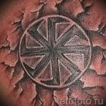 Фото тату коловрат - пример готовой татуировки на груди