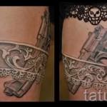Фото тату подвязка и оружие - тату белого цвета