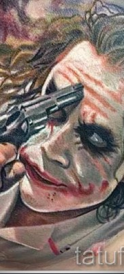 фото пример тату джокер и пистолет у лба
