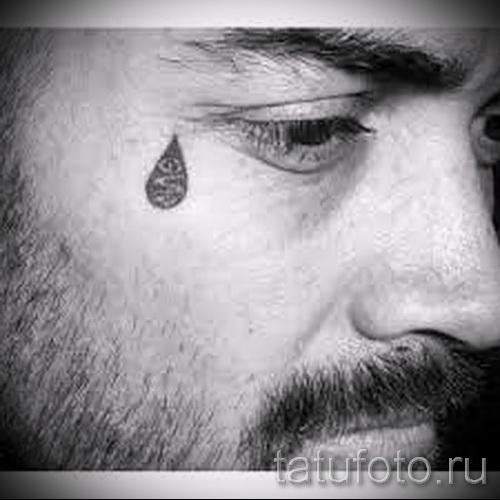 Тату слеза под глазом - пример на фото -  23